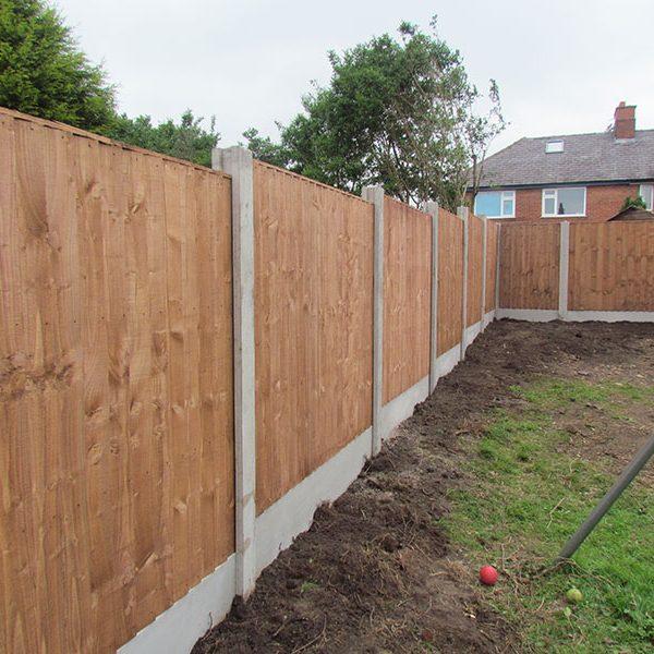 Vertical board fence erected
