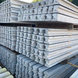 Stacks of concrete fence posts